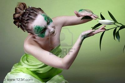 Portrait Of Green Witch Girl With Bodyart